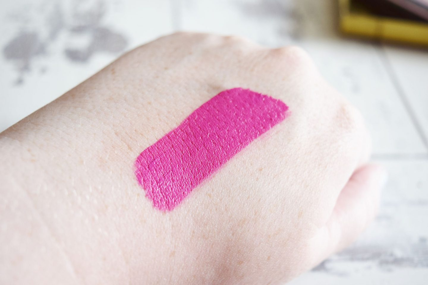 B. Makeup Matte Liquid Lipstick in Frolicked hand swatch