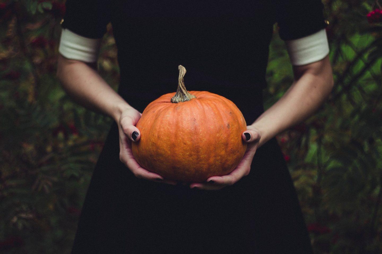 spooky girl holding pumpkin