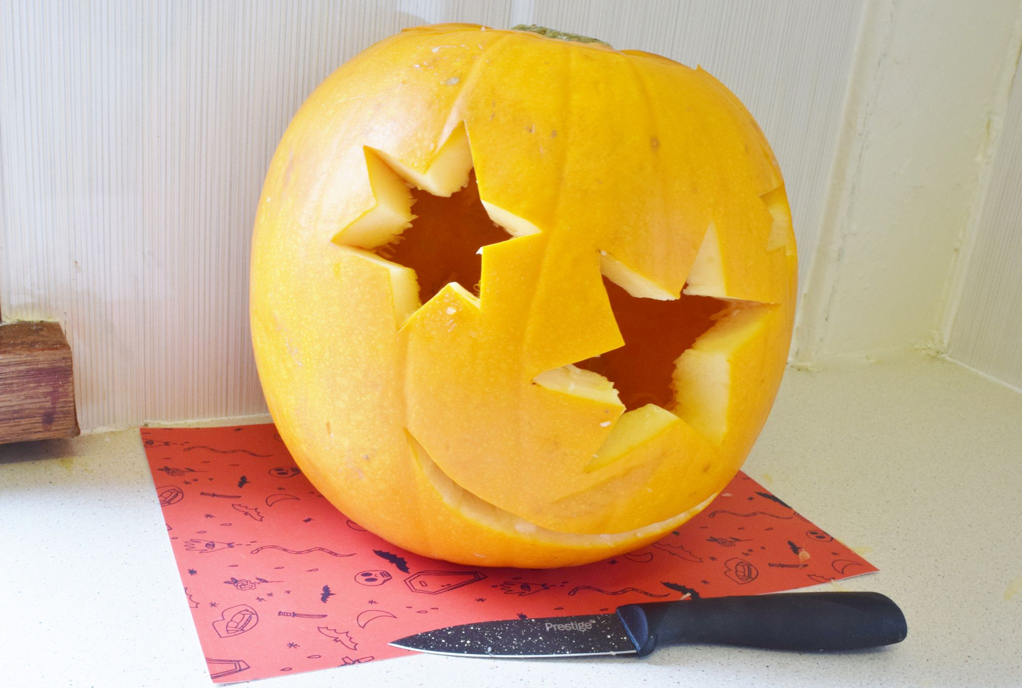 star face carved pumpkin