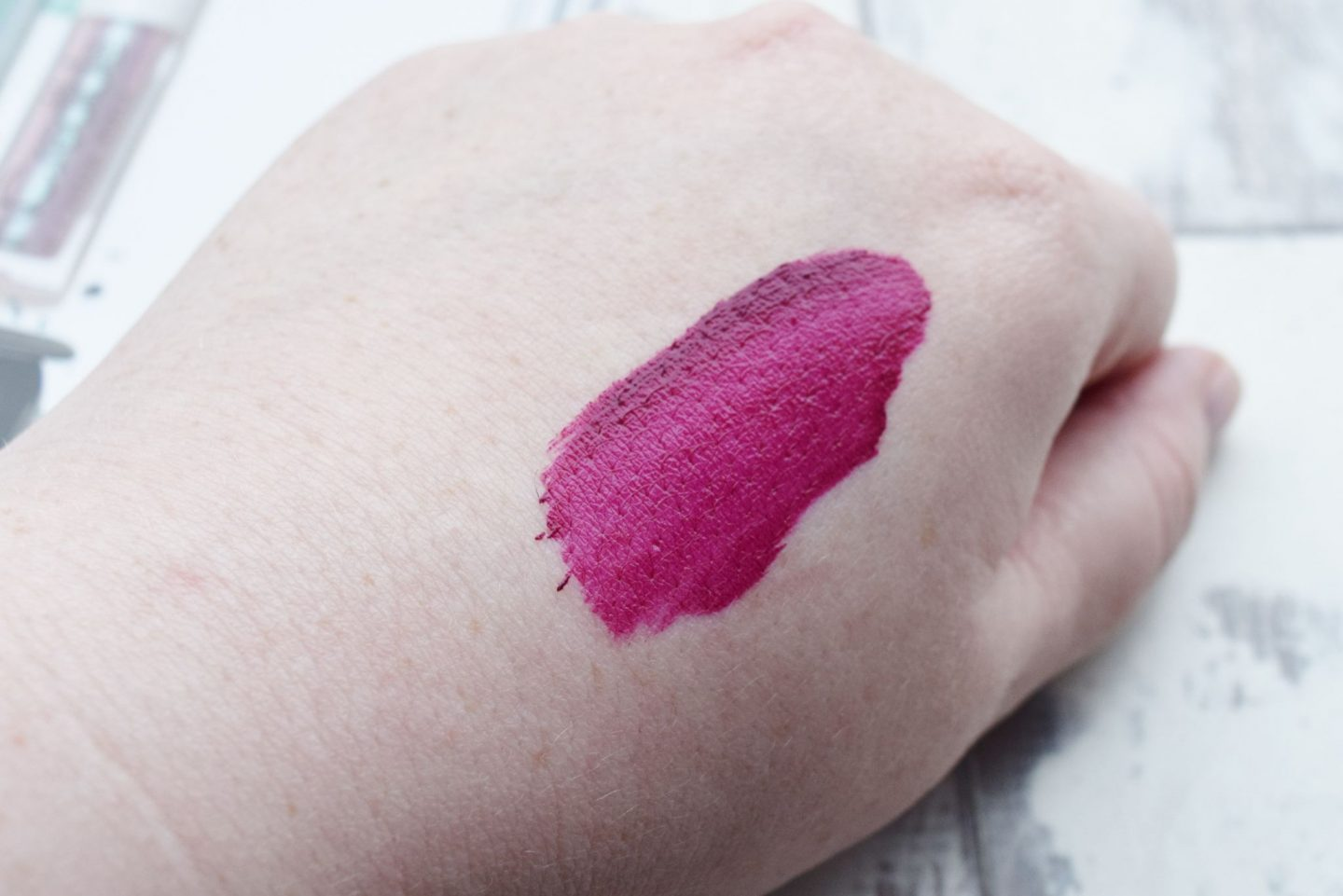 Estee Lauder Pure Color Envy Liquid LipColor in Orchid Flare swatch
