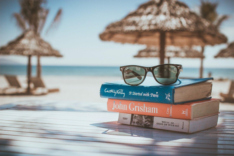 beach reading book pile